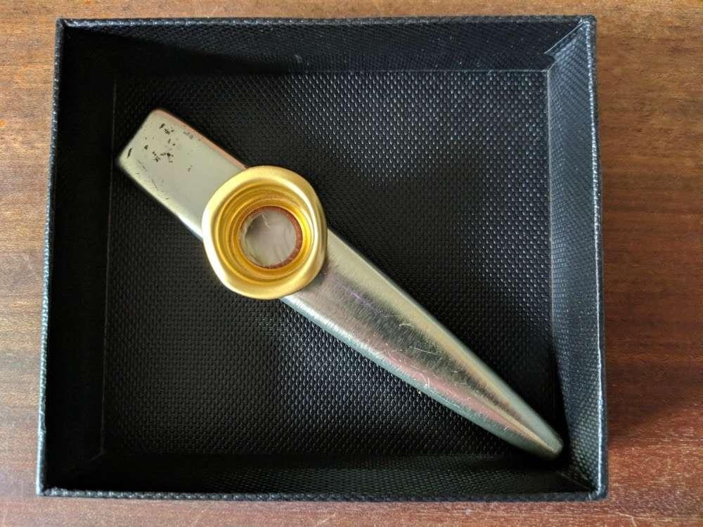 a kazoo in a presentaton box