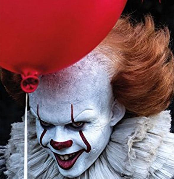 Pennywise the clown from IT, with a red balloon